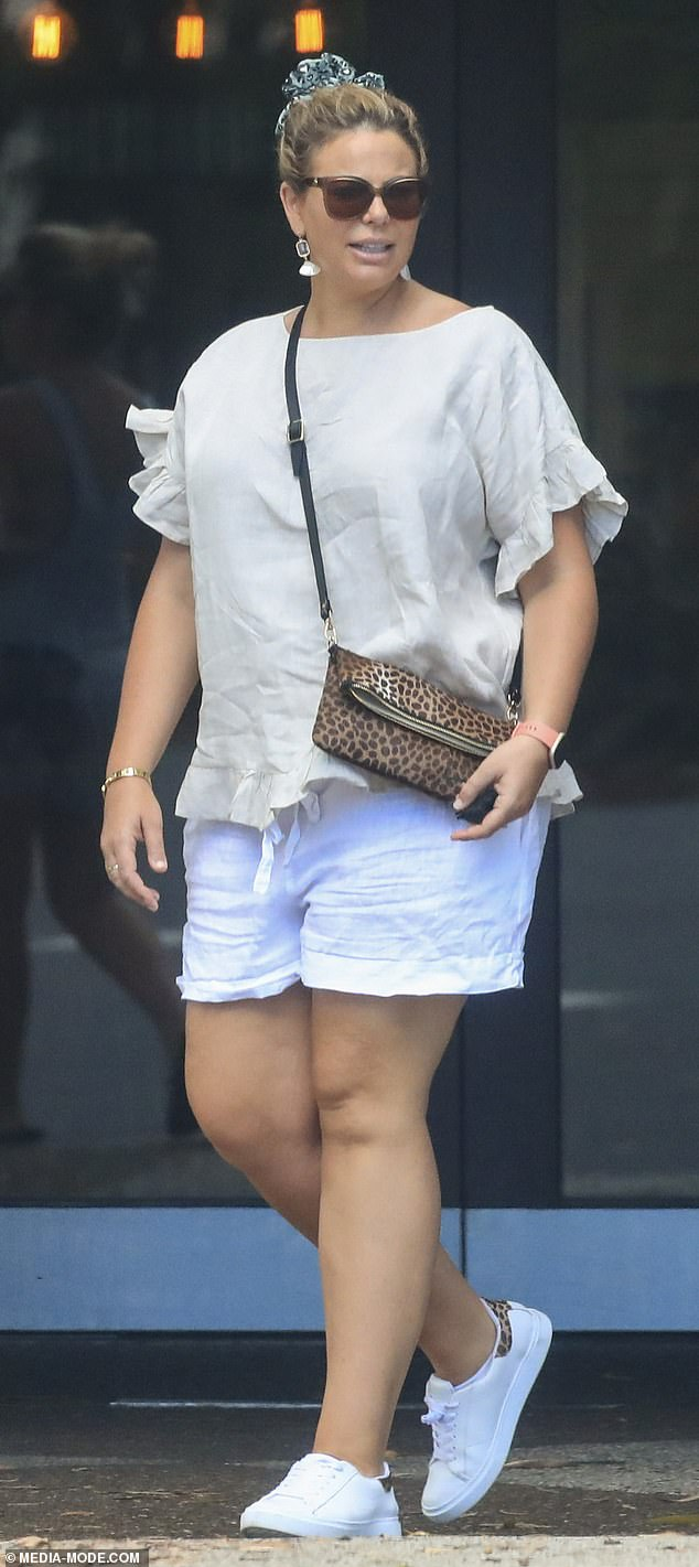 Yummy mummy! The former Biggest Loser host covered her baby bump with a floaty beige T-shirt and white shorts