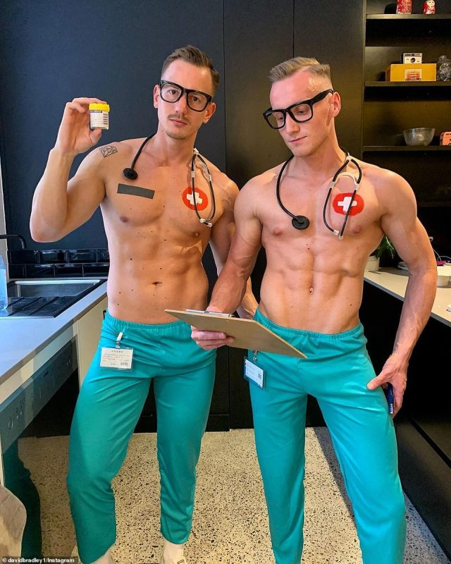 Two fit-looking men embracing the medical theme by wearing nothing but scrub bottoms, stethoscopes and clipboards