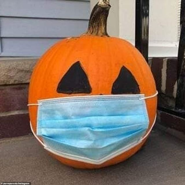 A family from Parramatta, in Sydney's western suburbs, fitted with a face mask onto a Jack-o'-lantern to match this year's coronavirus-themed Halloween celebrations