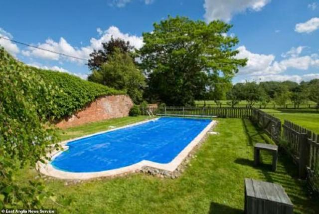 Flitcham Hall is believed to be the closest large period property to the Duke and Duchess of Cambridge's home Anmer Hall just over two miles away across open fields. Pictured, the outdoor swimming pool at the property