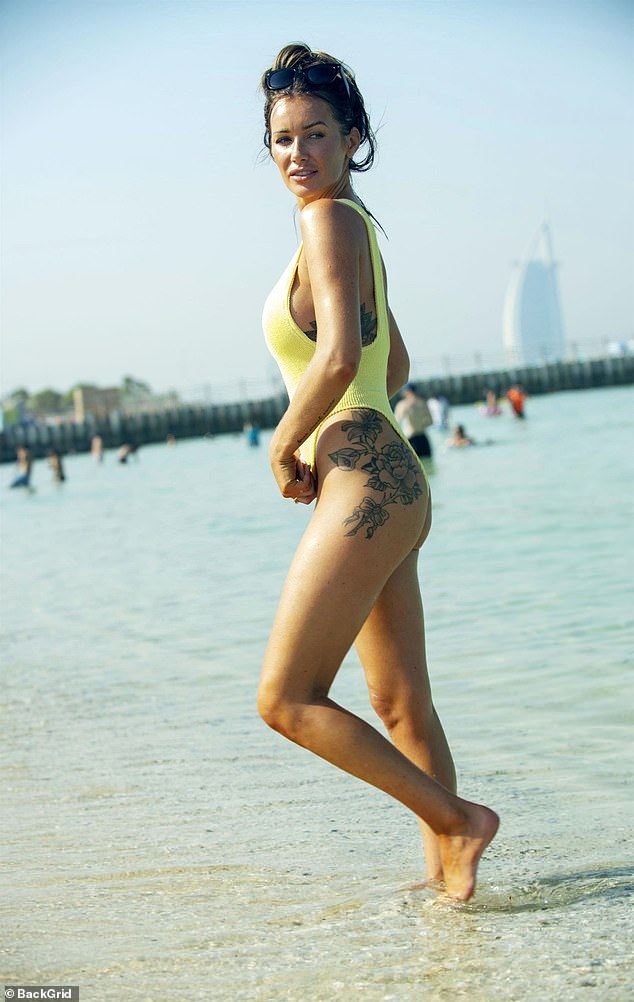 Sensational: Laura Anderson looked radiant as ever as she enjoyed a day at the beach during a recent trip to Dubai