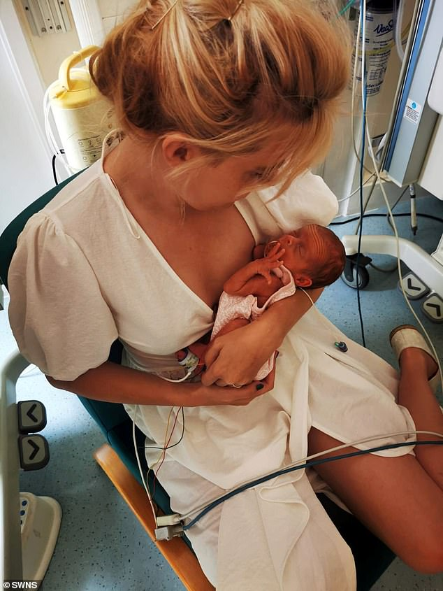 After Hannah gave birth in August, the youngsters spent five weeks in hospital due to their tiny size (pictured, Hannah with Evelyn)
