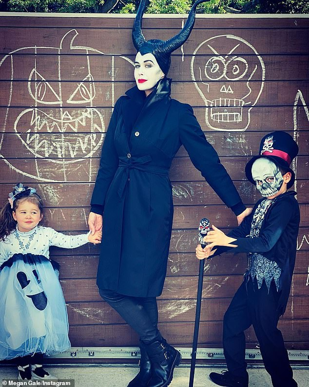 Family fun: Megan Gale, 45, transformed into Disney's Maleficent to celebrate Halloween this weekend with her children, son River, six, and daughter Rosie, two, (all pictured)