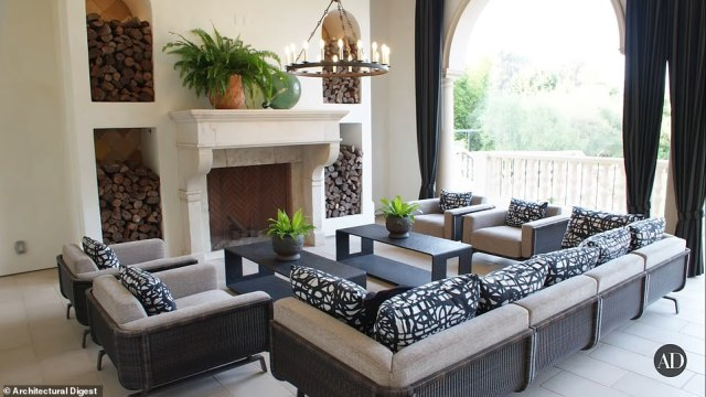 The luxury home features plenty of seating areas and antique fireplaces perfect for big gatherings