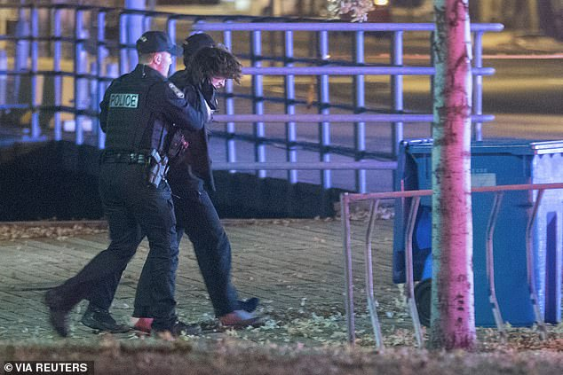 A 24-year-old man was arrested early Sunday in Quebec City after two people were stabbed to death and five were injured by a suspect wearing a 'samurai garb' and brandishing a sword