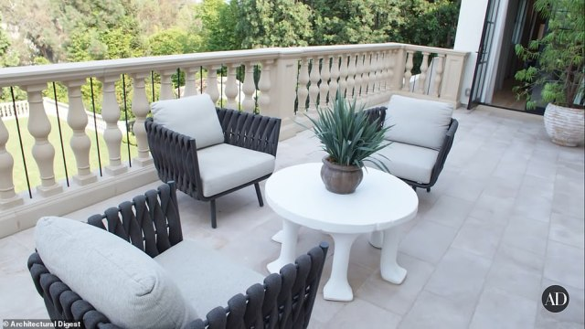 Take a seat! A view of the terrace connected to one of the bedrooms on the third floor pictured above with views of the extensive backyard