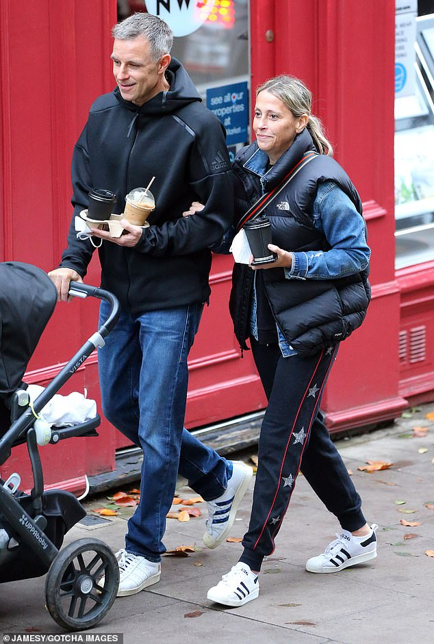 Stepping out:He appeared every inch the doting father as he pushed their daughter's pram with one hand, while juggling a selection of coffees in the other