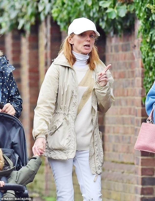 Laid back:Geri Horner cut a casual figure as she stepped out for a family stroll in London on Sunday