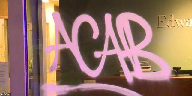 Graffiti was scrawled across some of the windows along MLK Blvd in Portland