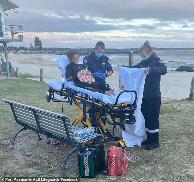 Oliver Paterno was surfing at Town Beach in Port Macquarie, on the mid-north coast, at 6am Monday when he was attacked by what is believed to be a reef shark