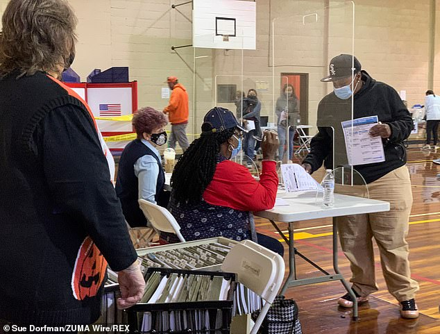 Poll workers are pictured handing out ballots in Robeson County, North Carolina