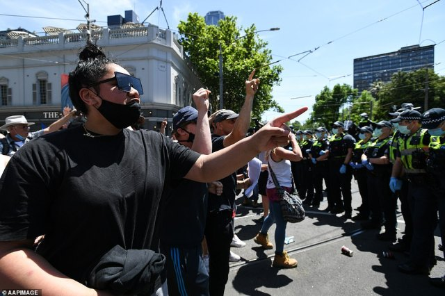 Over in Melbourne, protesters (pictured) unfurled banners such as 'Not Happy Dan' and 'Free Victoria', before breaking into chants for 'freedom'