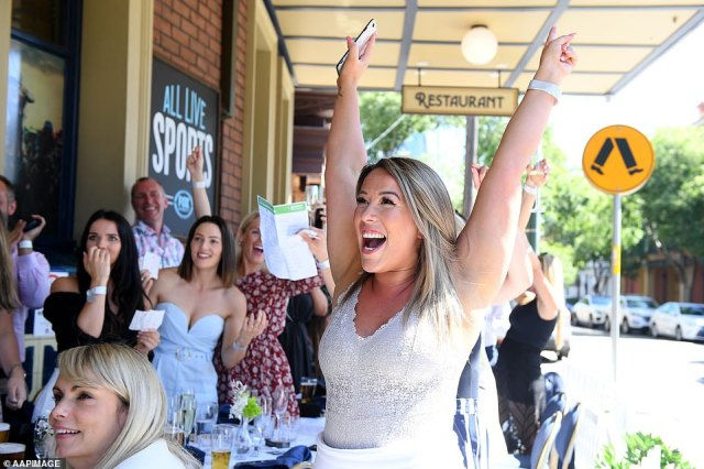 Melbourne Cup Day is celebrated by dressing up, drinking and watching the famous race with friends (Sydney pub pictured)