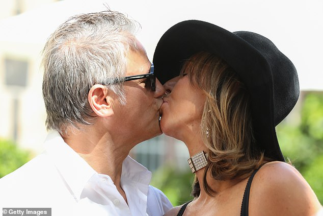 No social distancing here! Jon Stevens packed on the PDA with his girlfriend Heloise Pratt after his performance at the Melbourne Cup. Both pictured