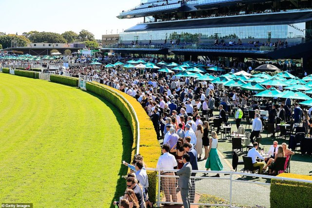 Punters at Randwick Racecourse (pictured above) are seen crowding together duringBentley Cup Day on Tuesday in what seemed a vaguely normal race day