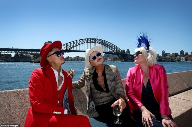 A group of punters are seen enjoying the sunshine and Melbourne Cup Day celebrations in Sydney Harbour (pictured on Tuesday)