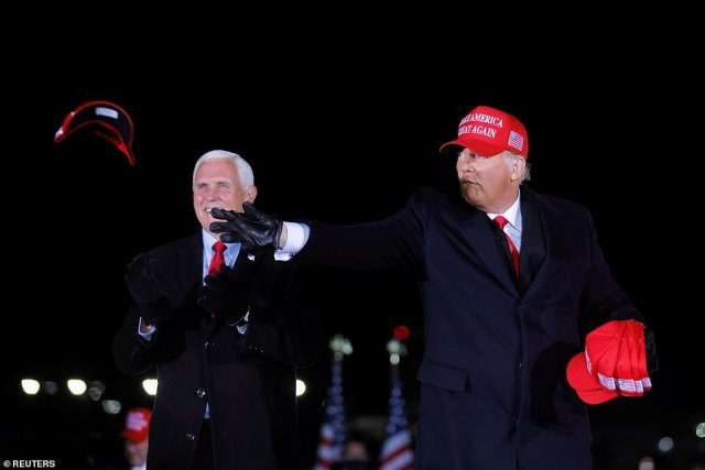 President Trump, with Vice President Mike Pence, throws red 'MAGA' hats to the crowds