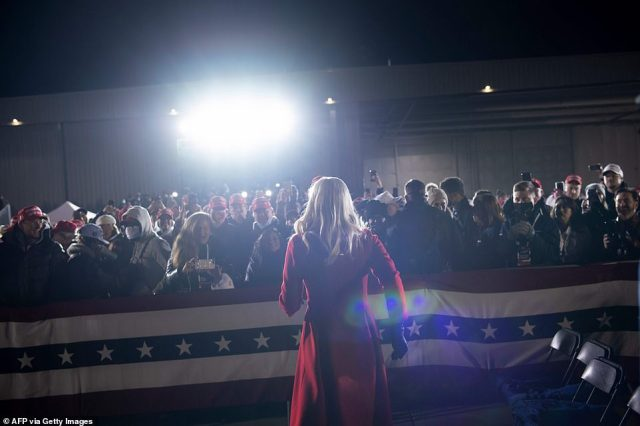 Ivanka Trump, in her striking red coat, speaks to fans of her father in Grand Rapids