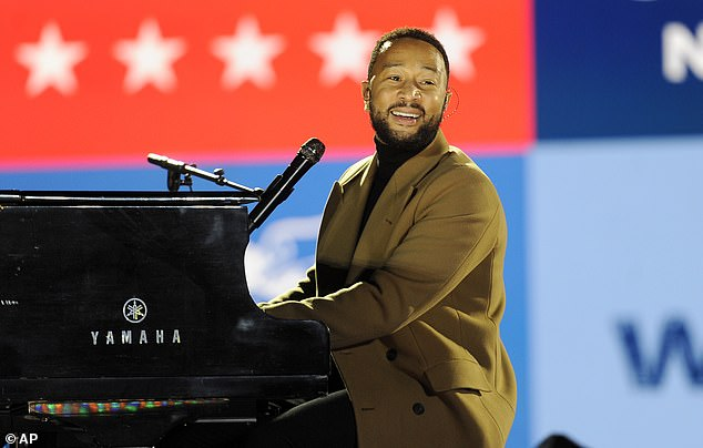 Speaking out: John Legend took the opportunity while performing at a political rally in Philadelphia, Pennsylvania in support of Joe Biden on Monday night to comment on fellow music stars who'veendorsed Donald Trump