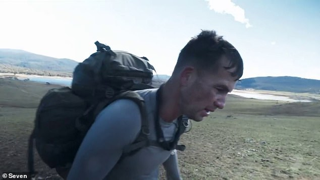 Challenging hike: Following a helicopter jump into freezing cold waters, the remaining recruits were then forced to endure a three-kilometre uphill hike in their soaking wet clothes