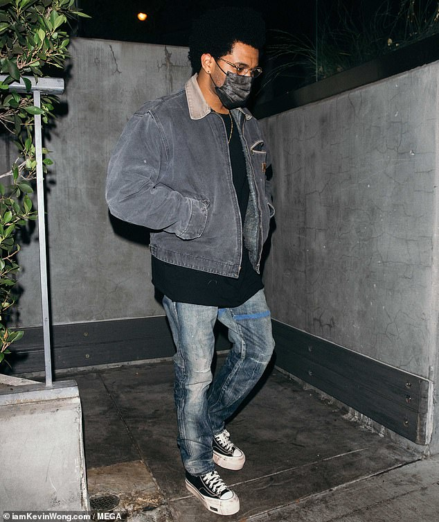 Stylish:The singer, 30, cut a casually cool figure in a T-shirt and denim bomber jacket while making his way into the swanky restaurant