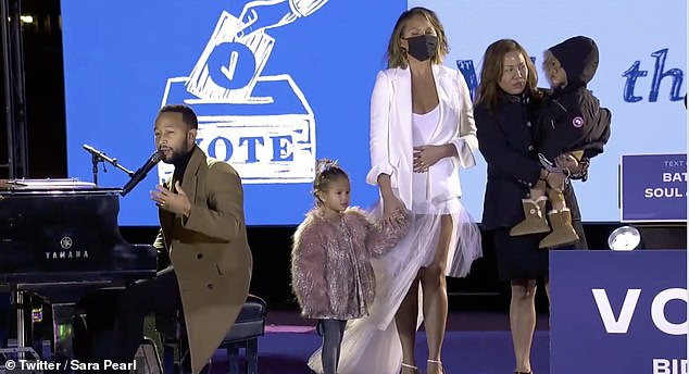 Sweet: Throwing her support behind democratic candidate Joe Biden and vice presidential candidate Kamala Harris, the model, 34, took to the stage with her husband John Legend, 41, and their two kids, to give an emotionally-charged performance
