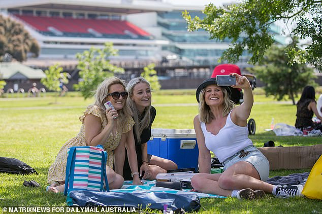 Pictured:Melissa (left) Jordan (middle) and Casey (right) celebrate the Melbourne Cup in Footscray Park, opposite Flemington Race Track