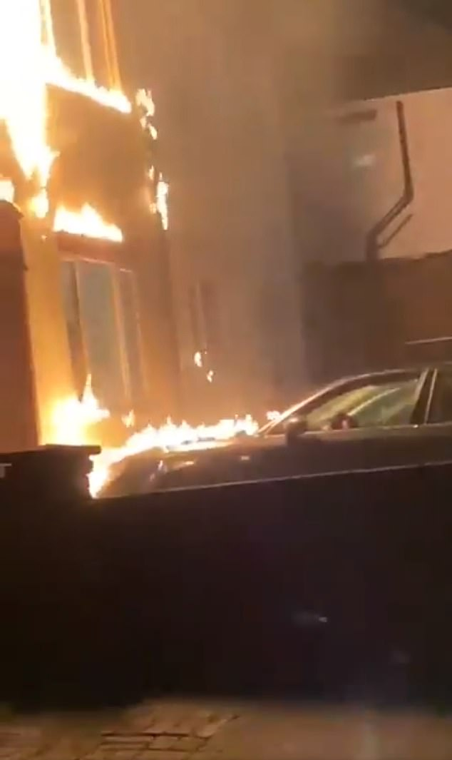 Footage posted on social media captures the moment the property went up in flames, with the firebomb sending licks of fire up the external walls