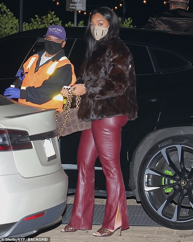 Wow! Kylie Jenner 's former friend, 23, turned up the heat in a pair of skintight maroon leather flares, which showcased her shapely pins and peachy posterior