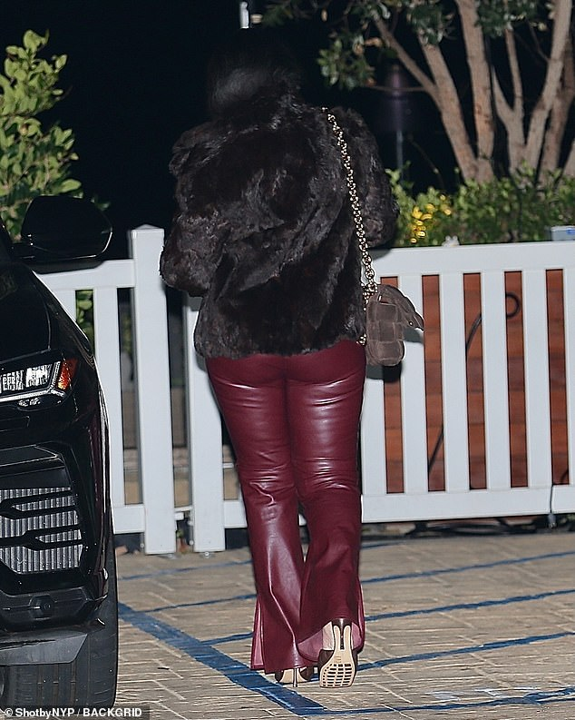 Peachy: She styled the trousers with a brown fur jacket, while she boosted her pint-sized frame with a pair of brown quilted heels