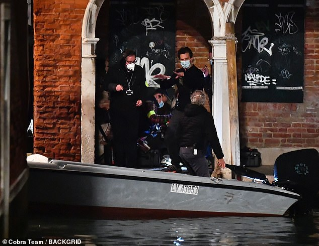 Small team: A camera crew of four or five people were on hand to film the scene with Tom