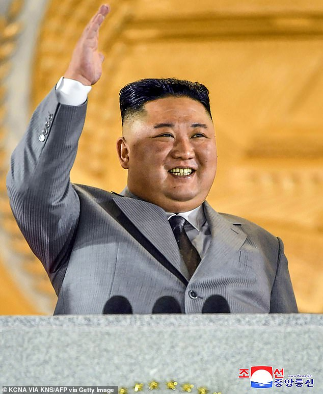 Pastor David Lee claimed people with symptoms are 'being forced into isolation, or being boarded up in their homes without food or other support and left to die'. Above, North Korean leader Kim Jong Un waves during the military ceremony in Pyongyang on October 10