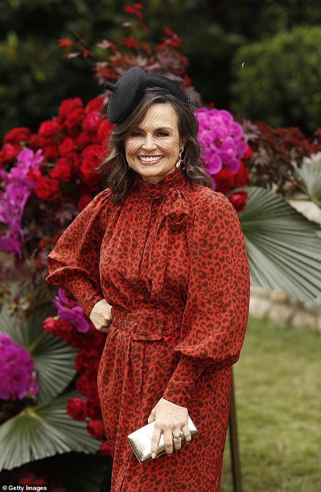 Roar:In that instance, she opted for a very similar vintage silhouette, choosing a red dress with an animal print.It featured puffed sleeves, a high neck tie and a pussy bow, with a cinched in waistline with a large belt, and again a modest hemline
