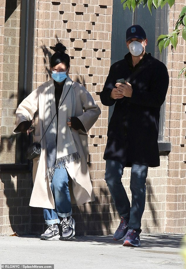 Out and about:The singer, 35, and the Stranger Things actor, 45, coordinated in protective face masks as they caught up during their casual outing