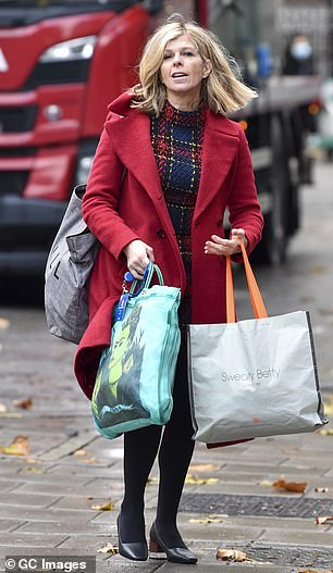Bundled up: She complemented the look with a tailored wool coat and black chunky kitten heels