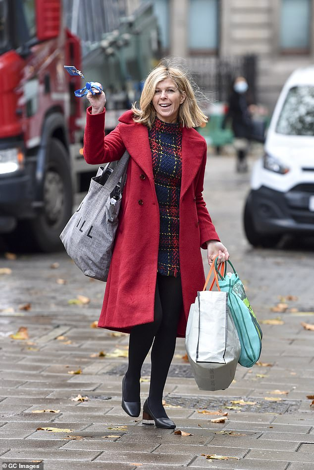 Friendly wave: Kate Garraway appeared in cheery mood as she arrived for work at Smooth Radio in London on Tuesday