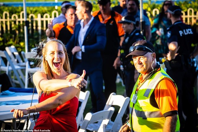 One race-goer lapped up the sunshine and offered the camera a thumbs-up towards the end of the event at the Doomben Race Course