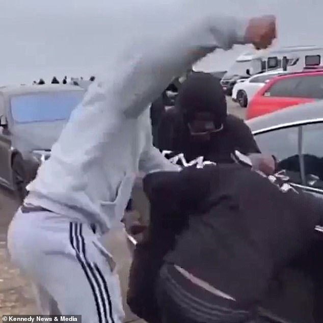 The brawl saw one man's head smashed against a car and another kicked in the face
