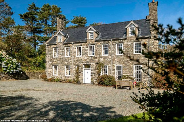 The exterior of the main house, pictured, which has nine bedrooms spread over two storeys along with a fully-equipped kitchen featuring period flagstone floor. An indoor swimming pool can further be found on the estate