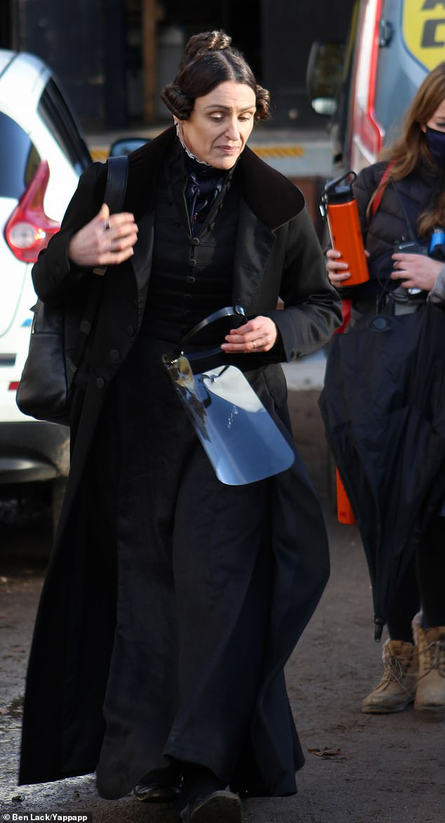 Prepared: According to the insider, Suranne 'had one of her staff ready to hand it to her as she walked off set. It was weird watching her put it on while still in 1830s costume'