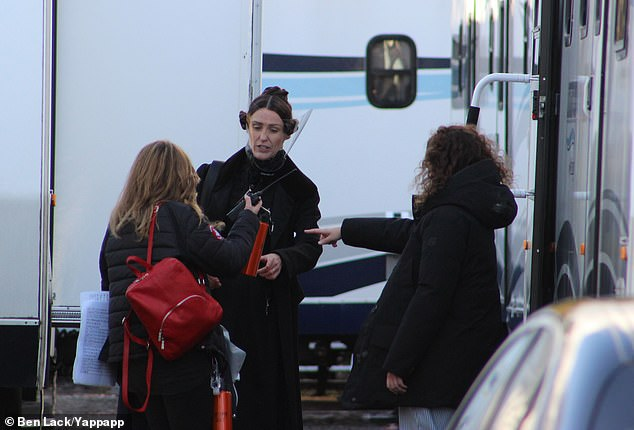 Protection: Suranne wore the shield in between takes as she made her way to her trailer before filming began