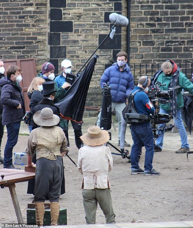 Taking no chances: The film crew were also seen wearing masks throughout the shoot as they worked hard on set of the BBC drama