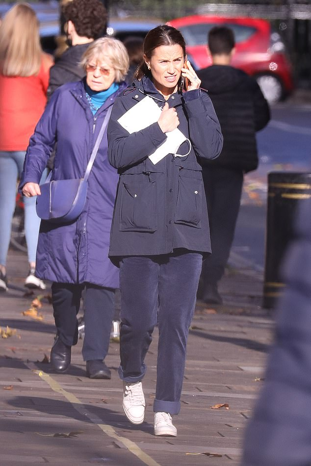 Pippa (pictured) wrapped up warm from the cold in a royal blue duffel coat which featured large pocket detail