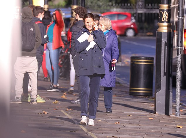 The Duchess's sister was busy chatting away on her phone as she walked up the high street in central London today