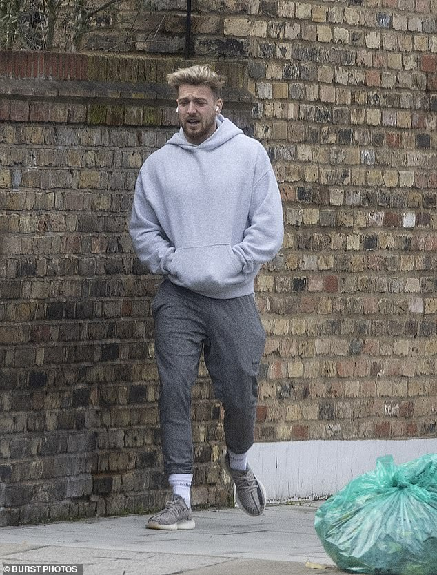 Comfort: Sam was casually clad for his outing as he stepped out in grey tracksuit bottoms with a lighter grey hoodie, while showing off a mussed hair style
