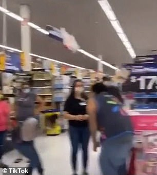 Captioned 'Who hurt my girl', a number of employees and shoppers alike are heard reaction with equal parts shock and laughter as Ragland's voice booms down on the store.