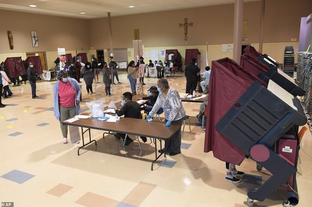 NEW ORLEANS, LOUISIANA: Voters arrive at St. Maria Goretti Church where five voting precincts are located as polls open