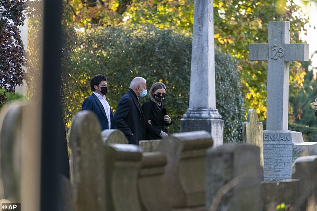 Biden takes a moment at his son's grave. Beau was laid to rest there following his death in 2015 from brain cancer