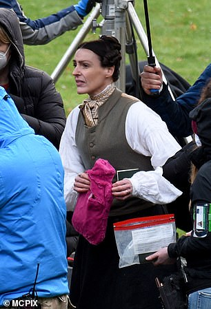 Staying warm: In between takes Suranne was seen holding a hot water bottle