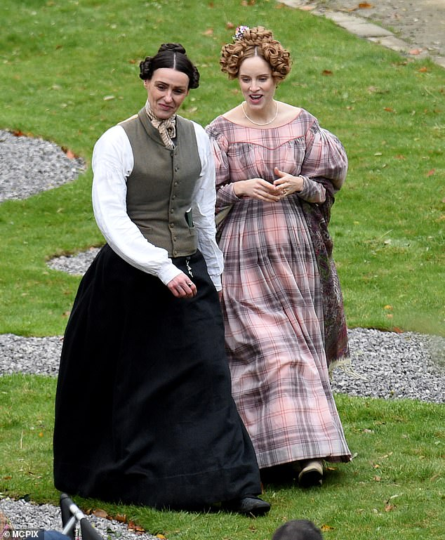 Filming:Suranne Jones looked cheerful as she was joined by co-star Sophie Rundle as they got back to work on the set of Gentleman Jack's second season in West Yorkshire on Tuesday